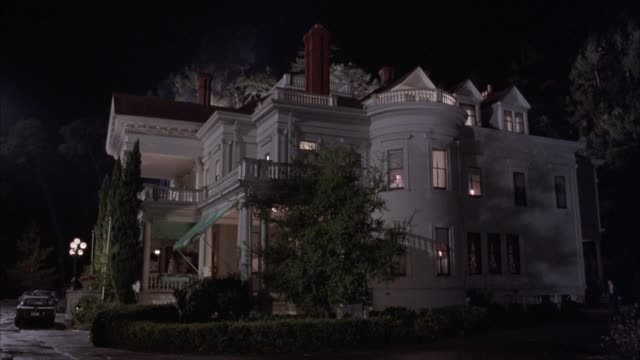 wide angle of dunsmuir estate in oakland, california. three story, victorian, upper class house or mansion with  turret and balconies in front. green awnings over entrance, cars parked at front entrance. could be hotel, inn, or bed and breakfast. matching - 19th century style stock videos and b-roll footage