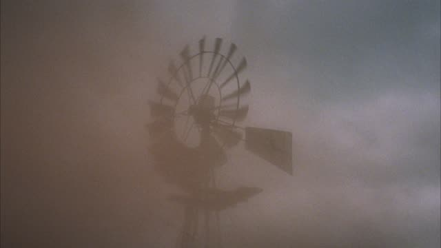 up angle of wind or weather vane spinning, sand blows by from left to right, sand storm. - sandstorm stock videos & royalty-free footage