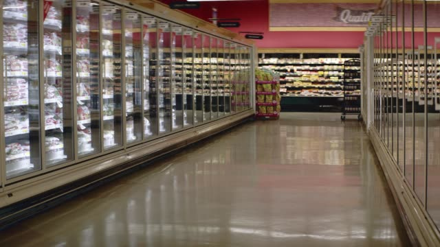 medium angle of freezer aisle of grocery store or market. - refrigerated section stock videos & royalty-free footage