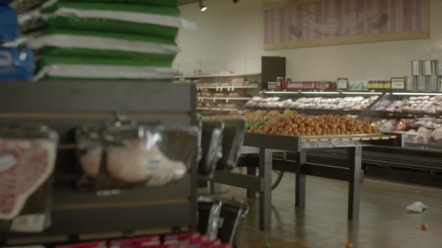 PULL BACK MOVING POV FROM PRODUCE CART IN GROCERY STORE OR MARKET TO SHELF OR STAND IN MIDDLE OF AISLE. COULD BE HIDING POV.