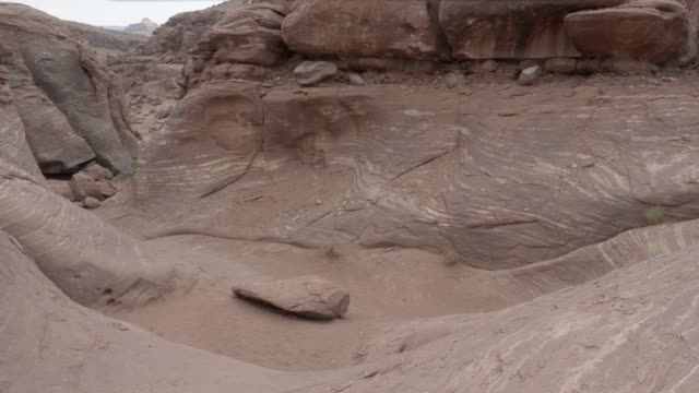 medium angle of rocky desert area. could be mesa or butte. - mesa stock videos and b-roll footage