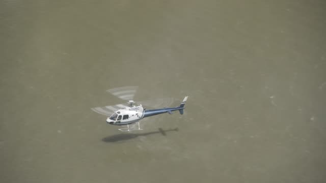medium angle of river in desert canyon or valley. helicopter visible flying or hovering over river. - 2013年点の映像素材/bロール