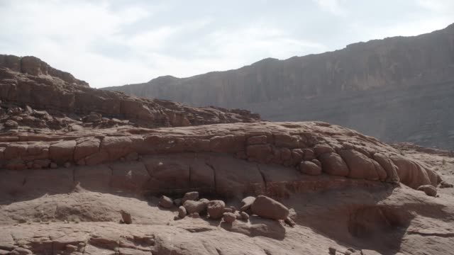 medium angle of rocks, buttes, or mesa in desert area. - mesa stock videos and b-roll footage