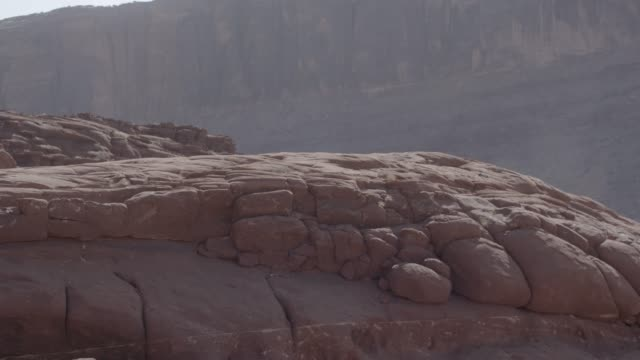 close angle of rocks in desert. could be butte or mesa. - butte rocky outcrop stock videos and b-roll footage