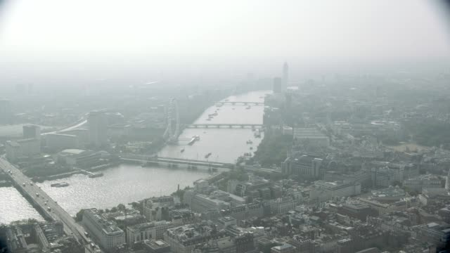 aerial over river thames and london skyline. london eye, big ben, parliament, and millennium bridge visible. landmarks. - skyline stock videos & royalty-free footage
