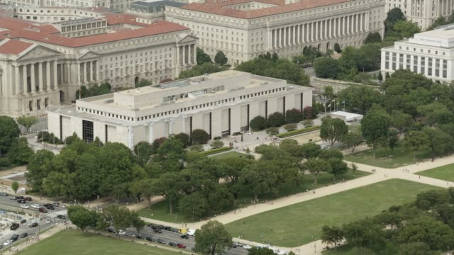 aerial of smithsonian museum of american history. multi-story government office buildings in washington dc city skyline. - amt stock-videos und b-roll-filmmaterial