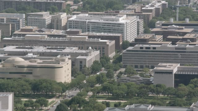 aerial of multi-story government office buildings in washington dc city skyline. national mall. smithsonian museums, national air and space museum. capitol building. domed building. landmarks. - smithsonian institution stock videos & royalty-free footage