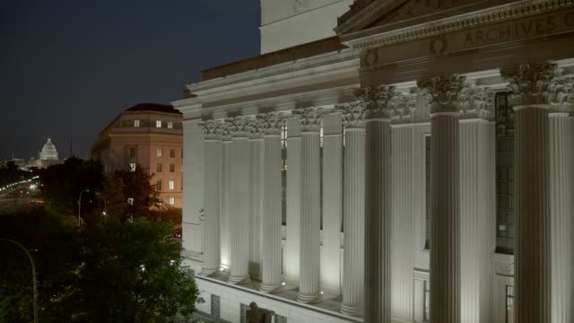 stockvideo's en b-roll-footage met pan right to left from national archives to capitol building, domed government office building. pennsylvania ave. or city street. washington dc city skyline. - national archives washington dc