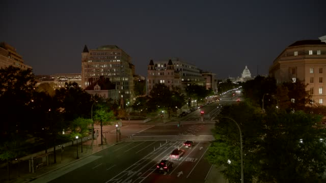 stockvideo's en b-roll-footage met pan left to right to national archives from capitol building, domed government office building. pennsylvania ave. or city street. washington dc city skyline. - national archives washington dc
