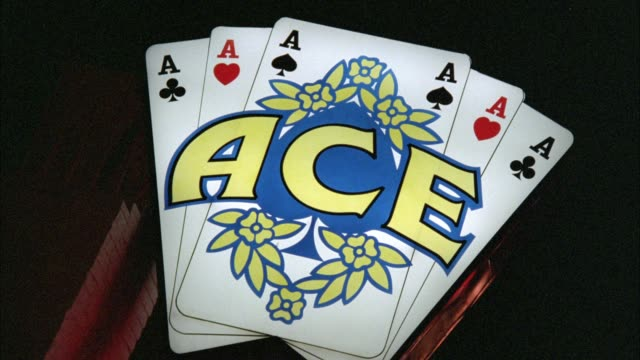 """close angle of sign reading """"ace."""" looks like a deck of playing cards. lights. - anno 1987 video stock e b–roll"""