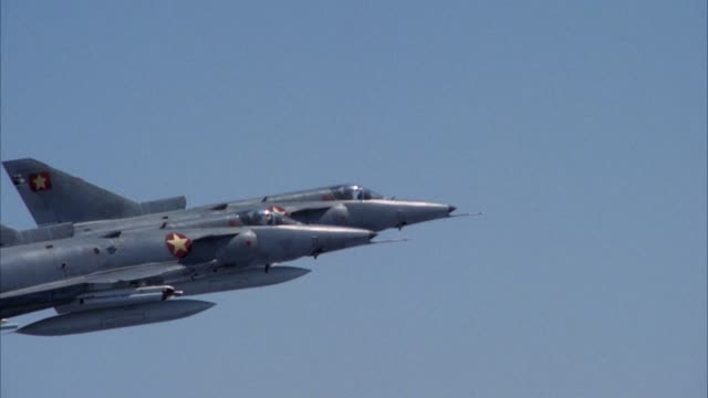 aerial of two saab viggen 37e fighter jet planes flying in formation. shot zooms in on jets. jets bank left out of shot. see bottom of plane, missiles. middle east. - missile stock videos & royalty-free footage