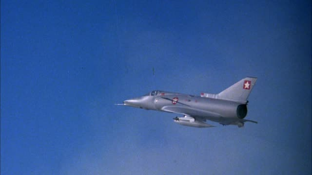 medium angle of model jet saab viggen 37e fighter airplane pov behind left wing. model then explodes or blows up for visual or special effect. see debris flying. see cone hanging from string at end of shot. explosions. middle east. - special effect stock videos & royalty-free footage