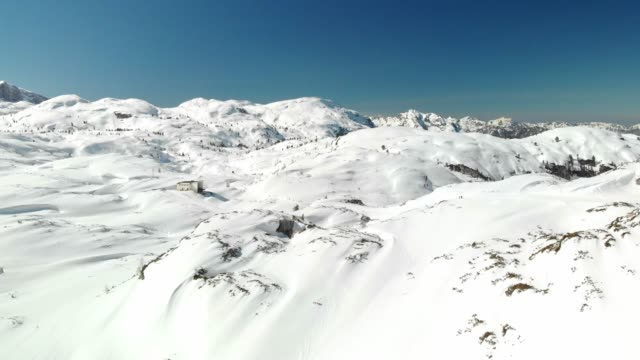 mesmerizing scenic aerial views in the winter mountains - dachstein mountains stock videos and b-roll footage