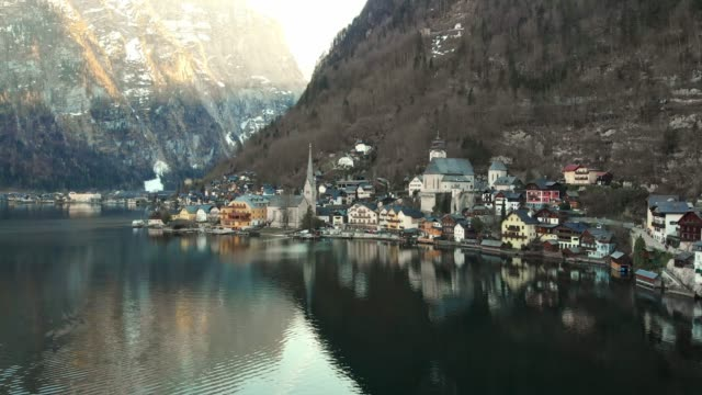hallstatt village - situated by the shore of hallstatter see lake - austrian culture stock videos & royalty-free footage
