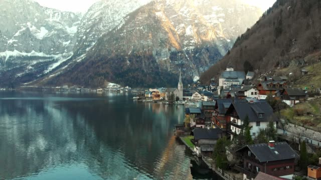 small alpine village of hallstatt by the hallstatter lake - austrian culture stock videos & royalty-free footage