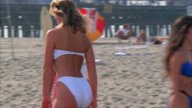 pan right to left venice or santa monica beach area. bikini-clad women roller skating by. - bikini stock videos & royalty-free footage