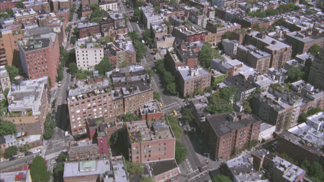 aerial of multi-story and high rise brick apartment buildings in residential area. could be tribeca, soho and the west village toward skyscrapers and office buildings in midtown manhattan. city skyline. - sony stock videos & royalty-free footage