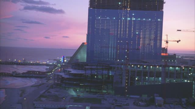 aerial of atlantic city. skyscrapers or high rise hotels, casinos. gambling. trump taj mahal. city skyline. atlantic ocean, beach or shore, piers and docks. - atlantic city stock videos & royalty-free footage