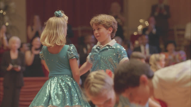 medium angle of children or kids in ballroom dancing competition bowing. dancers. - bowing stock videos & royalty-free footage