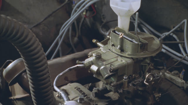 close angle of car or truck engine. could be at auto repair shop or garage. could be for mechanic. - 1998 stock videos & royalty-free footage