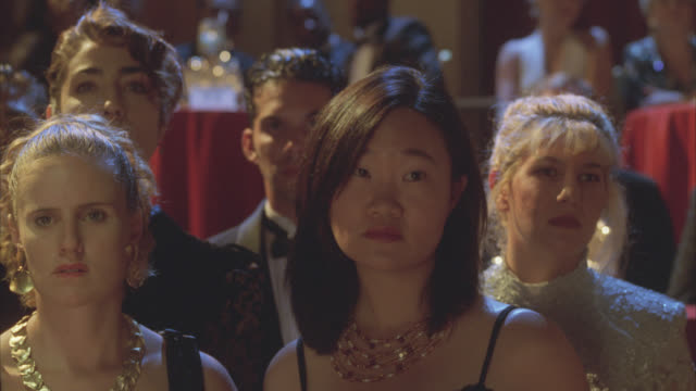 close angle of people in audience. formal, black tie attire. could be in theater, benefit or reception. - formal reception stock videos and b-roll footage