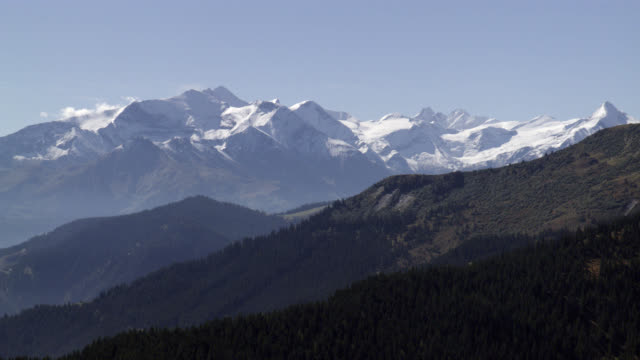 aerial of mountains, hills, forests, and valleys in bavaria. could be alps. snowy mountains. - schneebedeckt stock-videos und b-roll-filmmaterial