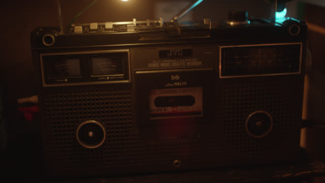 medium angle of jvc stereo radio cassette recorder. cassette tape visible in player. - loudspeaker stock videos & royalty-free footage