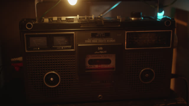 medium angle of jvc stereo radio cassette recorder. cassette tape visible in player. - stereo stock videos & royalty-free footage