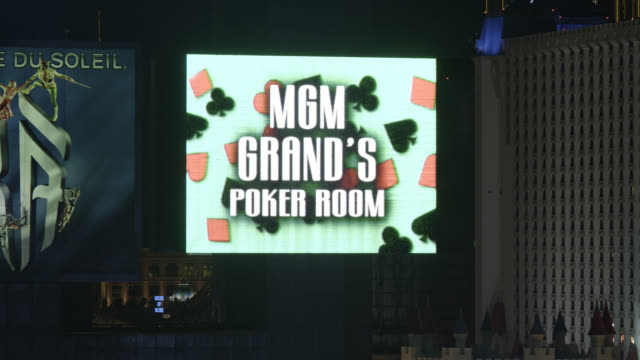 vidéos et rushes de pan left to right close angle to mgm grand neon sign in fg.  excalibur hotel and casino visible in bg. - billboard