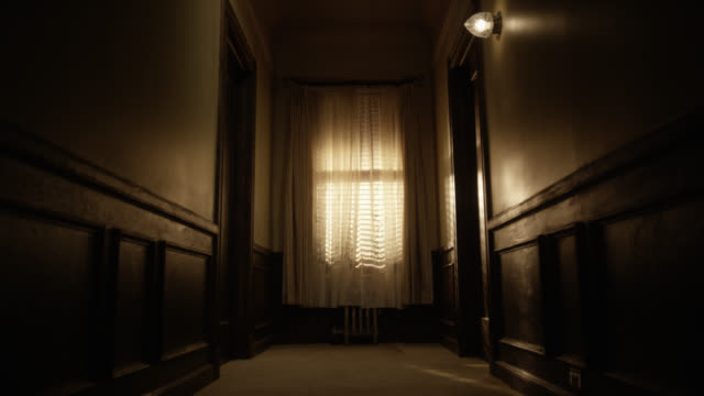 medium angle of wood paneled hallway with window and curtain. could be apartment building or victorian house. - victorian stock videos & royalty-free footage