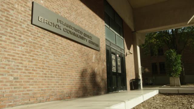 "medium angle of entrance to ""francisco cruz bronx community center"". brick building. - community centre stock videos & royalty-free footage"