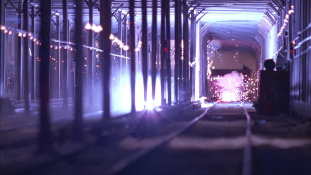 wide angle in underground subway tunnel. subway train rolls off tracks, and rolls over toward camera, smashing through support columns in a shower of sparks. smoke and dust. accidents. disasters. - train crash stock videos and b-roll footage