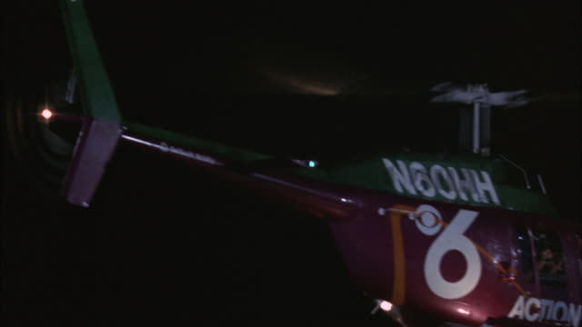 "medium angle of red helicopter with markings that read ""6"" and ""action news"" with nbc symbol. helicopter hovers then flies to up. - nbc stock videos & royalty-free footage"