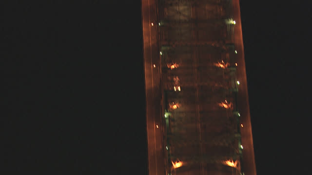 aerial of queensboro bridge over roosevelt island and east river. tracking shot birdseye pov of taxi or delivery car with illuminated top driving across bridge with cars and traffic toward queens, new york. city lights. - taxi stock videos & royalty-free footage