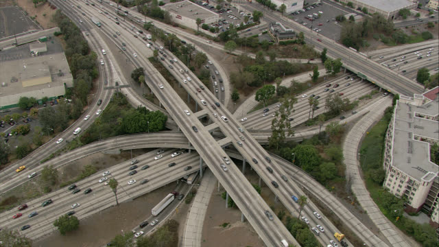 AERIAL OF HARBOR FREEWAY 110 AND HIGHWAY 101 INTERCHANGES . BIRDSEYE POV OF CARS, TRAFFIC. DOWNTOWN LOS ANGELES. OVERPASSES, RAMPS.