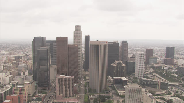 aerial of downtown los angeles skyline. city skylines. high rises, skyscrapers, and office buildings visible. us bank, aon tower, bank of america building. harbor freeway 110 with cars, traffic. highways. - us bank tower stock videos & royalty-free footage