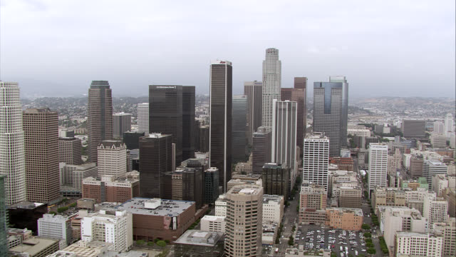aerial of downtown los angeles skyline. city skylines. high rises, glass skyscrapers, and office buildings visible. us bank, aon tower, bank of america, wells fargo buildings. - us bank tower stock videos & royalty-free footage