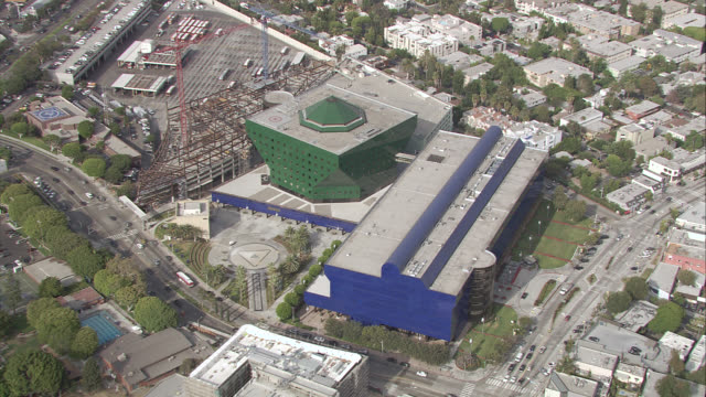 aerial of pacific design center in west hollywood, california. melrose and san vicente, near santa monica blvd. neighboring streets, houses, apartment and office buildings. - santa monica blvd stock videos & royalty-free footage