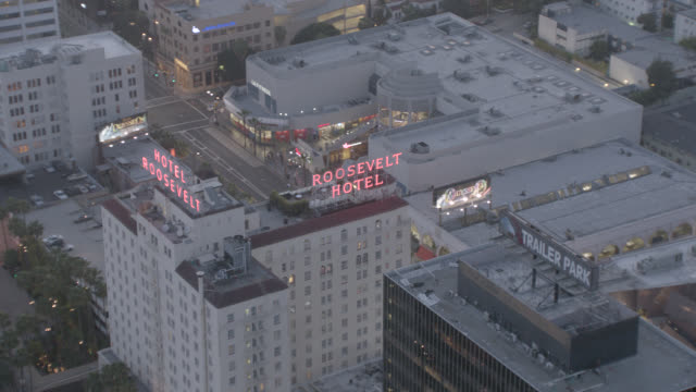 aerial of hollywood blvd. at dusk with main tourist attractions. tcl or mann's chinese theatre with celebrity foot and handprints, hollywood walk of fame in front. madame toussaud's wax museum, roosevelt hotel, hard rock cafe, el capitan and dolby theatre - hollywood entertainment museum stock videos & royalty-free footage