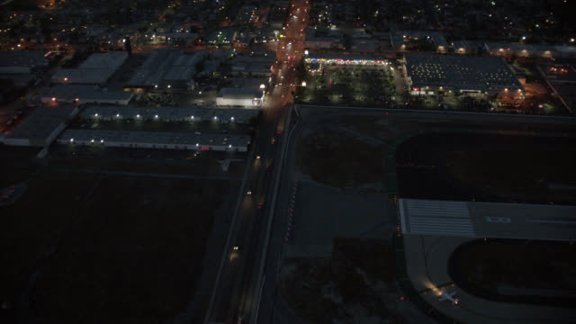 aerial of north hollywood and freeways with traffic, cars. other highways and mountains visible in far bg. dusk. san fernando valley. - other stock videos and b-roll footage