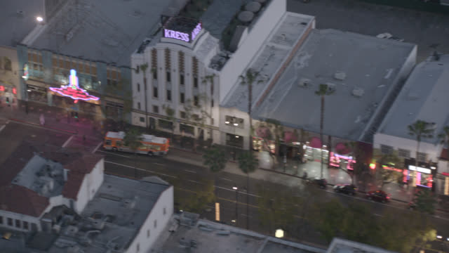 aerial of hollywood blvd. at dusk hollywood walk of fame, el capitan and dolby theatres, hollywood and highland center. billboards, people walking, cars, traffic. - el capitan theatre stock videos & royalty-free footage