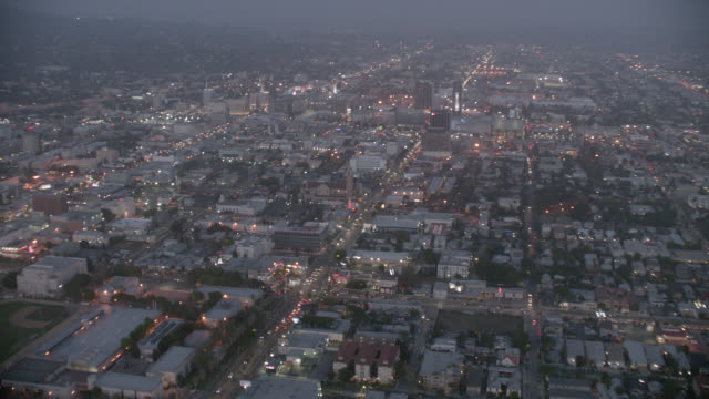 aerial of city streets and building rooftops in hollywood area near hollywood and highland. theatres, roosevelt hotel, apartment buildings, high rises, city lights, cars, traffic. - the dolby theatre stock videos & royalty-free footage