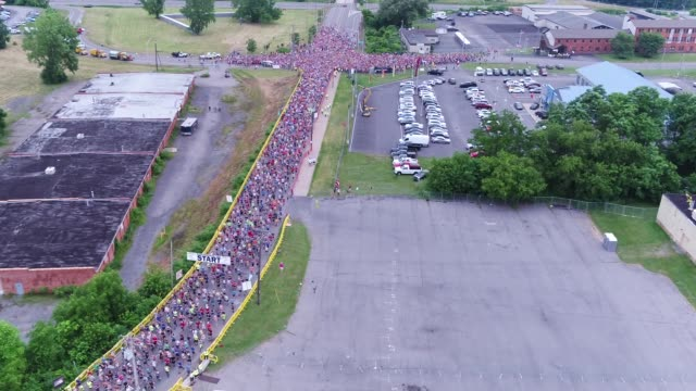 drone running race thousands head out to course - salmini stock videos and b-roll footage