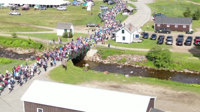 drone running race up mt washington start - salmini stock videos and b-roll footage