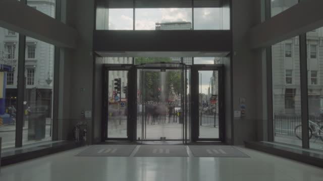 london - broll - revolving door timelapse - revolving door stock videos & royalty-free footage