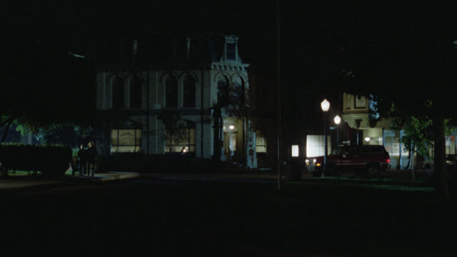 red bronco drives through small town and out of frame right   lafiamma and lundy in bronco cam holds on small town church chapel very short - 礼拝堂点の映像素材/bロール