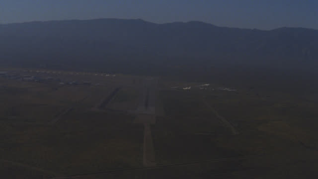 aerial pov approach to runway airstrip air strip landing field at airport  this is the pilot's pov coming in for a landing lights on runway are lit up  lighted matching dx 1329-b  and other nx 1329-c 1327-e 1329-a out of focus - other stock videos & royalty-free footage