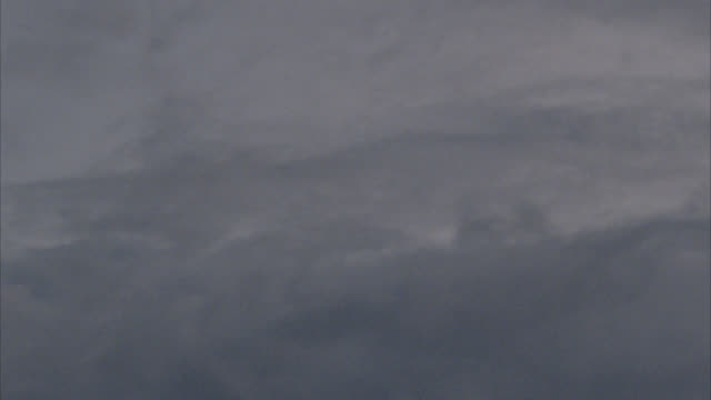 medium angle view of dark and gloomy sky during storm or stormy weather. storm clouds. - french overseas territory stock videos & royalty-free footage