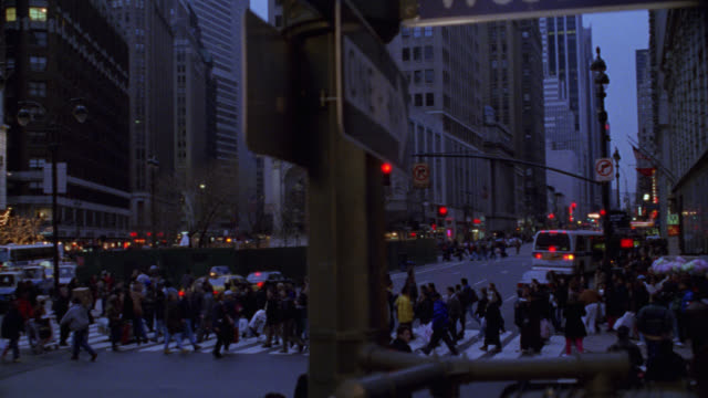 pan right to left from street corner signs to macy's department store in harold square new york city. see sixth avenue and west 34th street signs and one way sign with tall office buildings in background. pan down to pedestrians in crosswalk and on sidewa - corner stock videos & royalty-free footage