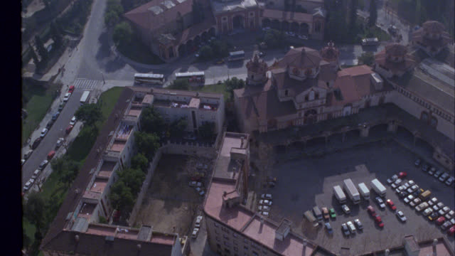 aerial of barcelona. large multi-story building, could be a hotel, palau nacional museum, a large square building with a dome structure on top. montjuic communications tower visible in bg. europe. - hotel nacional stock videos and b-roll footage